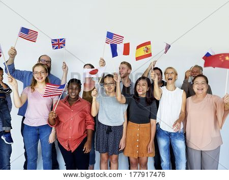 Group of people holding national flags studio portrait