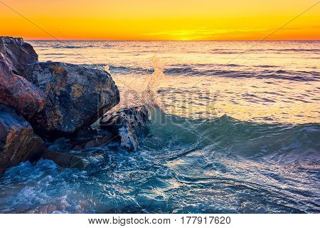 Waves crashing on the rocks at sunset near Glenelg Beach South Australia