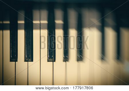 Piano keyboard background with selective focus and blur. Blur keyboard and musical notes