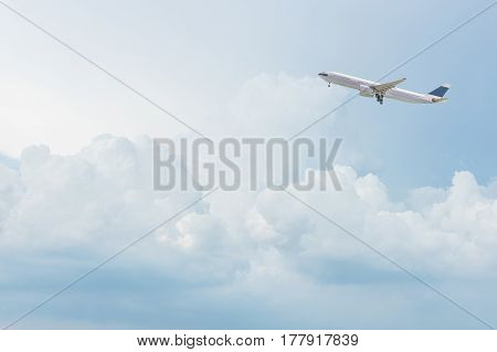 Commercial airplane flying over bright blue sky and white clouds. Elegant Design with copy space for travel concept