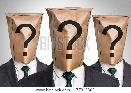 Three Business Mans With A Bag On The Head
