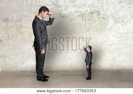Big Businessman And Small Businessman Watch Each Other