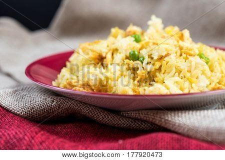Homemade Chinese fried rice with vegetables and fried eggs