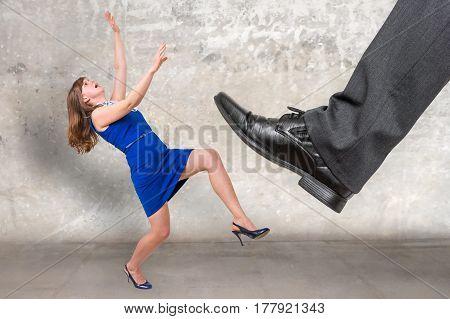 Businessman Big Foot Kicking Small Businesswoman