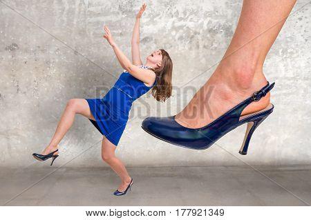 Businesswoman Big Foot Kicking Small Businesswoman