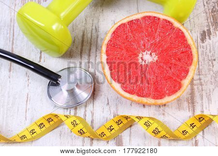 Fresh Grapefruit, Centimeter, Stethoscope And Dumbbells, Healthy Lifestyles