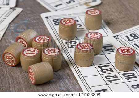 An old board game lying on a wooden table. Still life objects
