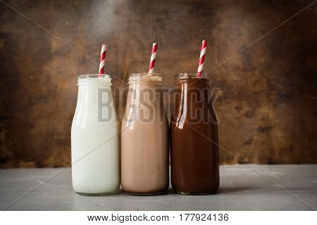 Three Different Sorts Beverage Bottle Wooden Background