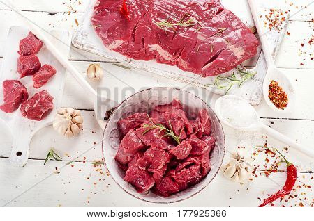 Raw Beef Seasonings On A Wooden Table.