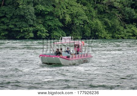 Touristic Boat With Passengers At Rheinfall, Largest Plain Waterfall In Europe