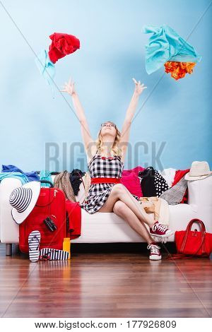 Woman Throwing Up Clothes, Clothing Flying Everywhere