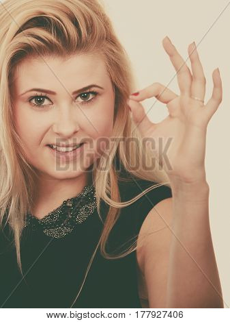 Blonde Woman Showing A Ok Gesture