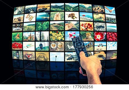 Screens forming a big multimedia broadcast video wall with remote control - retro style