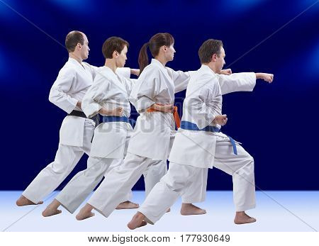 On a dark blue background the athletes are beating punch arm