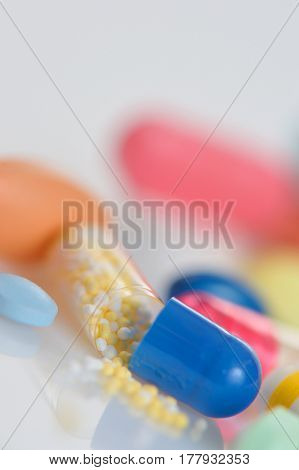 many different pills on table
