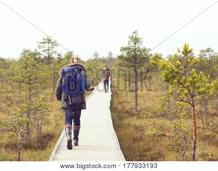 Two handsome, bearded men  hiking in swamps. Camp, adventure, trip and fishing concept.