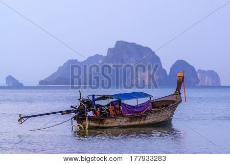 Traditional long-tail boat on the beach in Krabi Thailand