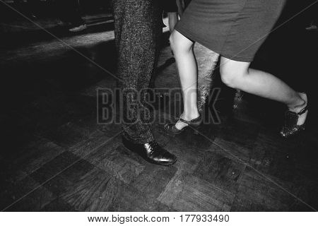 swing dancers in ballroom vintage and black and white style