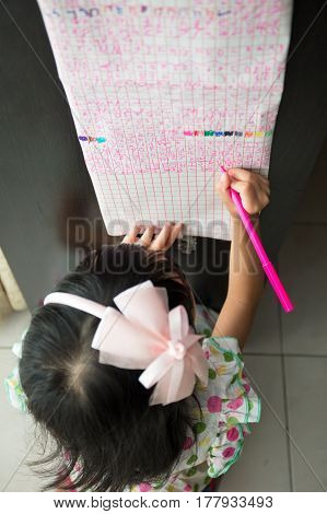Asian Chinese Little Girl Writing On Paper In The Morning
