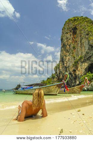 Classy woman on the Thai beach of Railay in Krabi