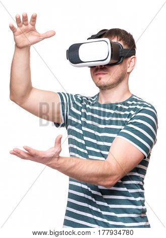 Happy man wearing virtual reality goggles watching movies or playing video games on white. Male getting experience using VR-headset glasses of virtual reality at home much gesticulating hands.