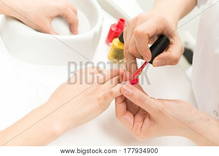 Manicure process in beauty salon close up of female hands