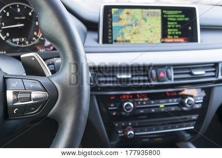 Sankt-Petersburg, Russia, March 05, 2017: Hands free and media control buttons on the steering wheel in black leather, modern car interior of BMW X5M 2017 on test-drive in Sankt-Petersburg at March 05 2017