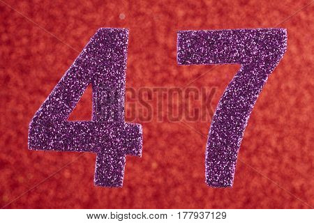 Number forty-seven purple color over a red background. Anniversary. Horizontal