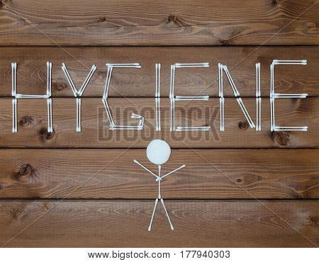 Inscription hygiene And man Made with cotton buds on wooden background