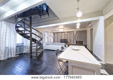 Russia,Moscow - modern living room interior. Duplex apartment with a stylish spiral staircase. poster