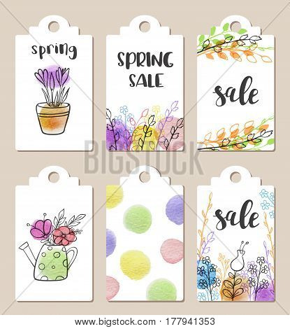 Set of hand drawn tags for spring sale with watercolor textures and flowers