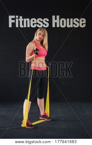 Fit Woman Exercise In Fitness Studio With Elastic Bands