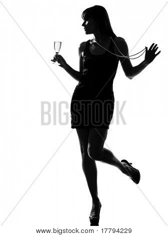 stylish silhouette caucasian beautiful woman partying drinking champagne flute glass cocktail full length on studio isolated white background