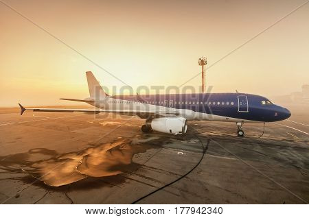 the plane in the fog on the Runway of-dawn