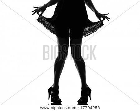 stylish sexy silhouette caucasian beautiful woman legs pulling her summer dress on studio isolated white background