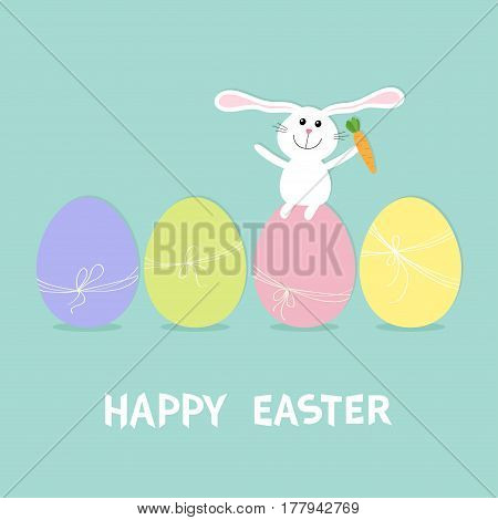 Happy Easter bunny. Rabbit with carrot sitting on painting egg shell set. Painted eggs with thread and bow. Farm animal. Cute cartoon funny character. Greeting card Blue background. Flat design Vector