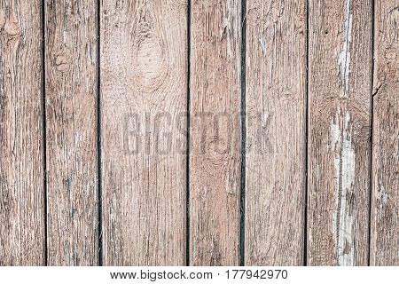 Wooden grunge background from the old brown unpainted boards closeup