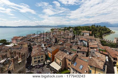SIRMIONE ITALY - MAY 5 2016: View of colorful old buildings in Sirmione and Lake Garda from Scaliger castle wall Italy