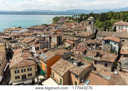 SIRMIONE ITALY - MAY 5 2016: View of colorful old building in Sirmione and Lake Garda from Scaliger castle wall Italy