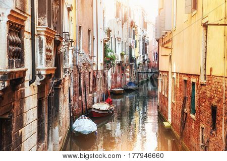 Gondolas On Canal In Venice. Venice Is A Popular Tourist Destination Of Europe.