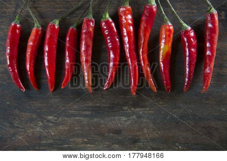 Red hot chilli pepper on wooden tabel background
