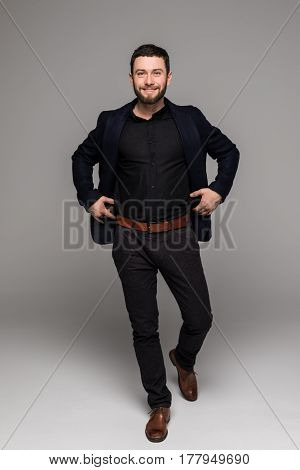 Full Length Bearded Business Man In Black Suit Isolated Gray Background