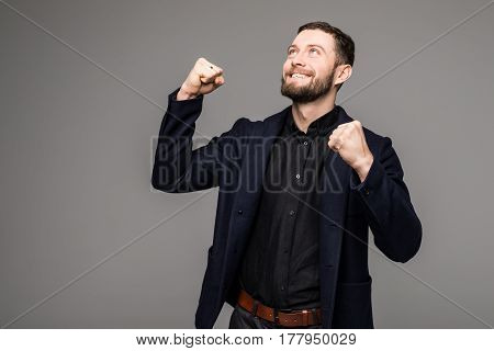 Handsome Young Businessman Gesturing And Smiling