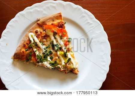 Slice Of Pizza With Mayonnaise On Plate Detail. Wooden Table