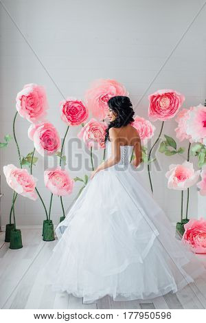 Portrait of a beautiful fashion bride, sweet and sensual. Wedding make up and hair. Flowers background. Art modern style.