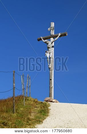 Cross on the top of a mountain in Dolomites, Italy