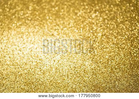 The yellow glittering abstract light as background