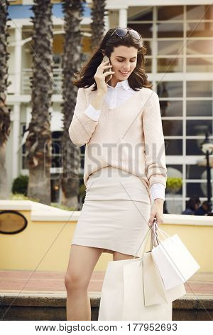 Beautiful woman on telephone call in city