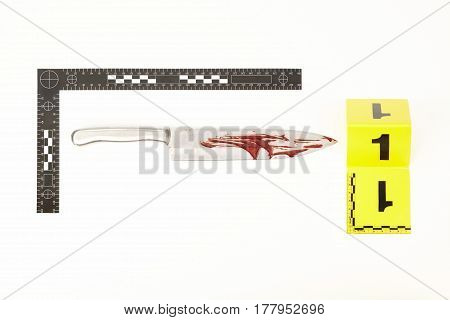 Metal knife with forensic scale as a evidence of violent crime