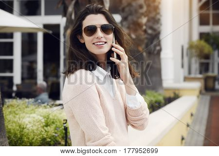 Young Beautiful brunette woman on call portrait